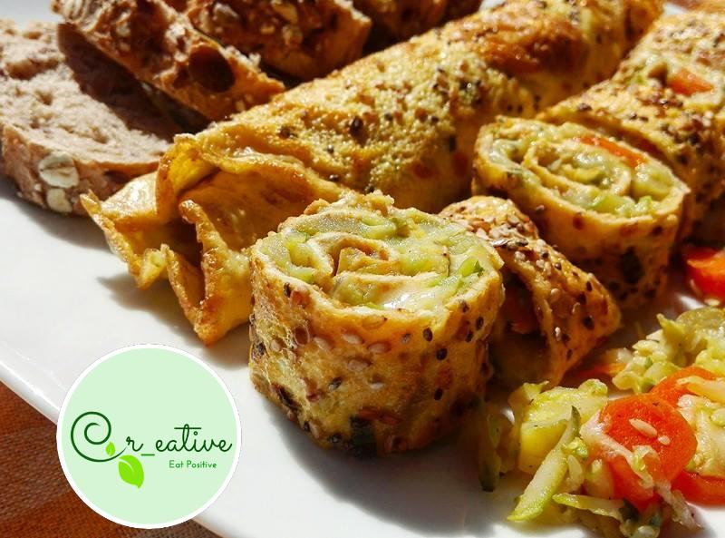 Omelette-Roll in salsa di verdure e grana